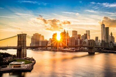 Wall mural Brooklyn Bridge and the Lower Manhattan skyline at sunset