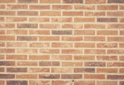 Wall mural Brown stone brick wall texture and background seamless.