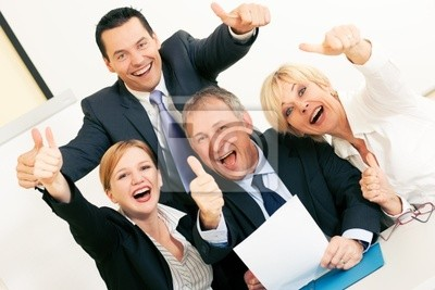 Business people in office celebrating success