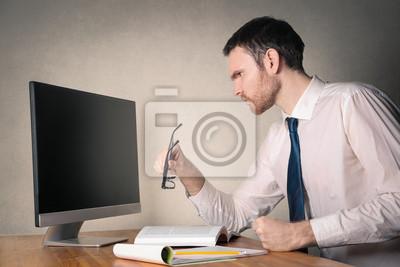 Businessman looking at a blank monitor