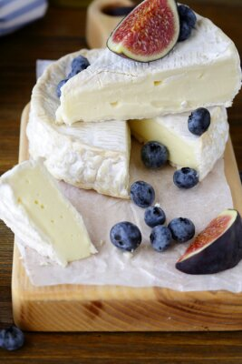 Wall mural camembert cheese with figs and blueberries