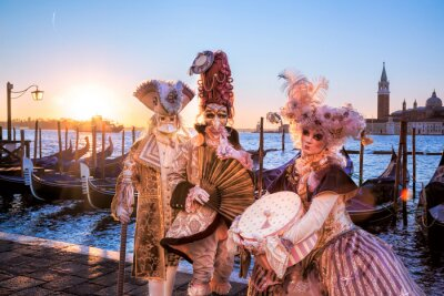 Wall mural Carnival masks against sunrise in Venice, Italy