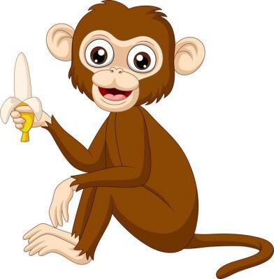 Cartoon funny monkey holding banana
