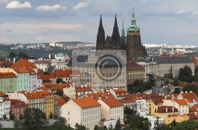 Castle and buildings with red roofs of Prague city, Czechia