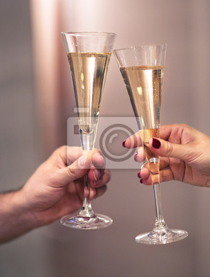 Champagne glasses in man and woman hands