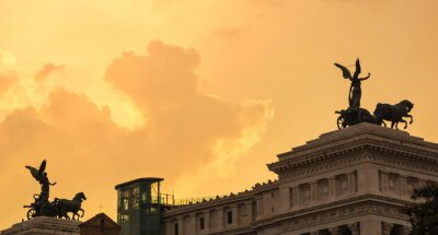 Chariots of ancient Roman goddess of Victory Nika in  backlight against  sunset