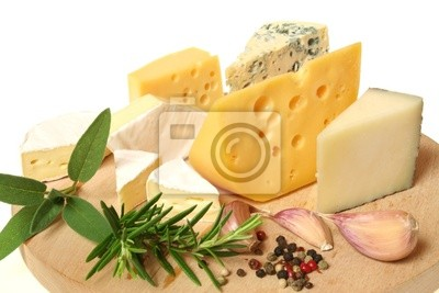 Wall mural Cheese and herbs on a wooden board. Food photography.