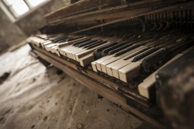 Wall mural Chernobyl - close-up of an old piano