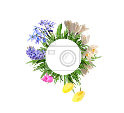 circle from flowers in grass isolated on a white background