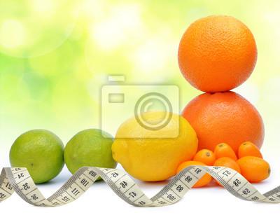 Citrus fruits ( Orange, Grapefruit, Lemon, Lime, Kumquat ) with measuring tape. Concept of healthy eating.