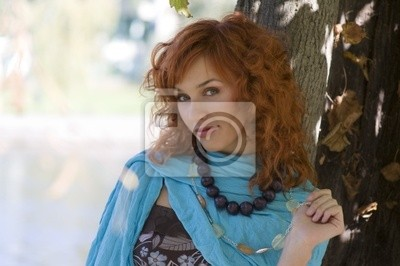 close up of a cute red haired girl with sky-blue scarf necklace