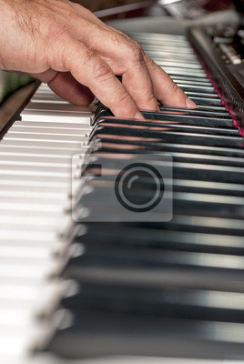 Wall mural Close up of a piano being played