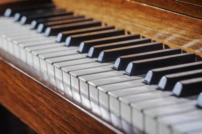 Wall mural Close up of piano keyboard with limited depth of field