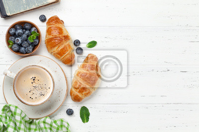Wall mural Coffee and croissants breakfast