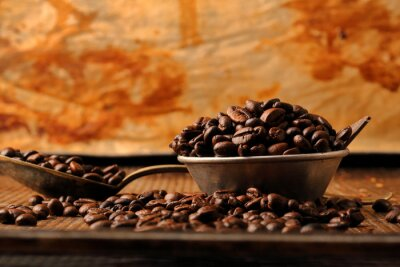 Wall mural Coffee beans and dark chocolate in bowl in vintage style