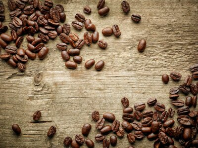 Wall mural Coffee beans on wooden table