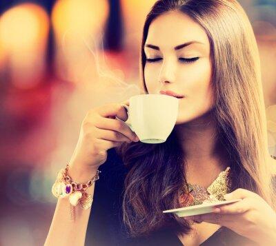 Wall mural Coffee. Beautiful Girl Drinking Tea or Coffee