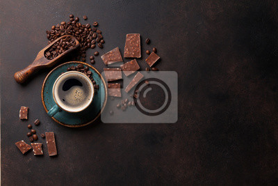 Wall mural Coffee cup and chocolate on old kitchen table