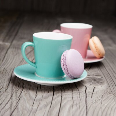 Wall mural Coffee cups with french macaroons on table