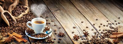 Wall mural Coffee Espresso Cup With Beans And Cinnamon On Wooden Table