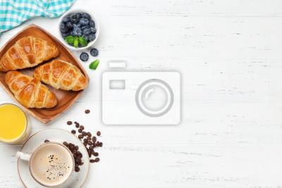 Wall mural Coffee, juice and croissants breakfast