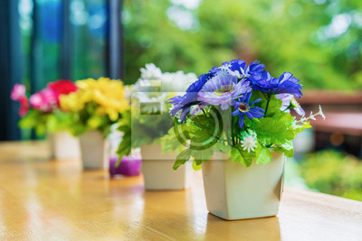colorful decoration artificial flower in pot on table