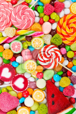 Wall mural Colorful lollipops and candy. Top view.