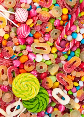 Wall mural Colorful lollipops and different colored candies.