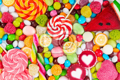Wall mural Colorful lollipops and different colored round candy.