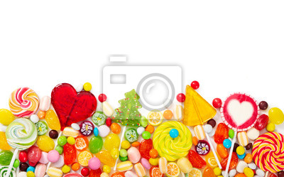 Wall mural Colorful lollipops and different colorful candy isolated on white