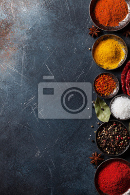 Wall mural Colorful spices on stone table