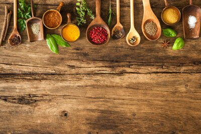Wall mural Colorful spices on wooden table