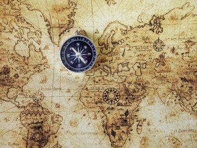 Wall mural Compass on vintage map. Retro style.