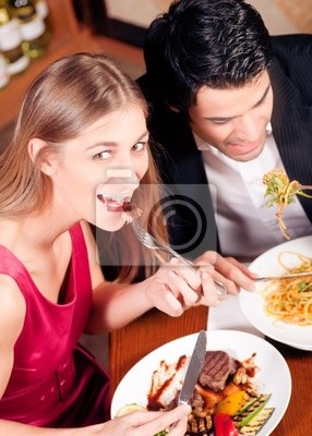 Couple eating dinner together