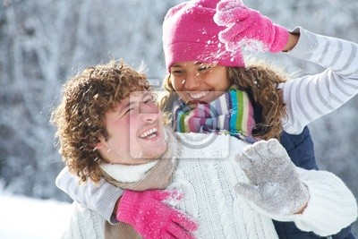 Couple playing snowballs