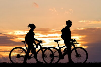 Wall mural couple with bike at sunset