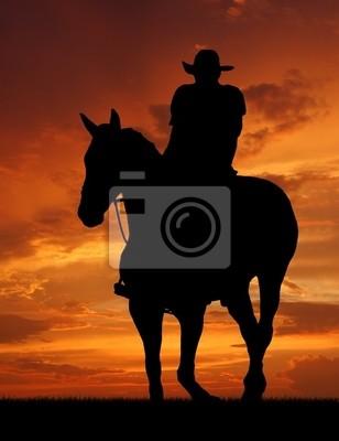 Wall mural cowboy silhouette in sunrise