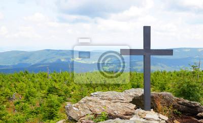 Cross on the mountain summit Svaroh in the national park Sumava, Czech Republic.