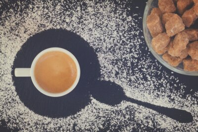 Wall mural cup of coffee espresso with sugar, top view, retro toned