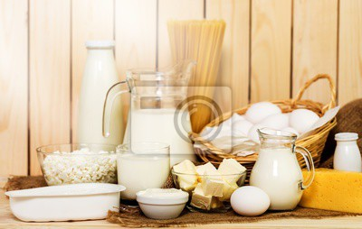 Dairy products collection on wooden table