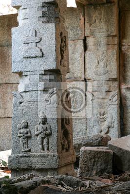 Decorative stone pillar in hampi ruins