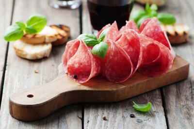 Wall mural Delicious salami with basil and wine