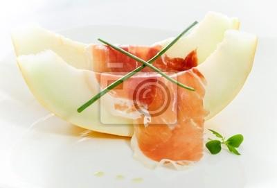 Delicious sliced melon and bacon