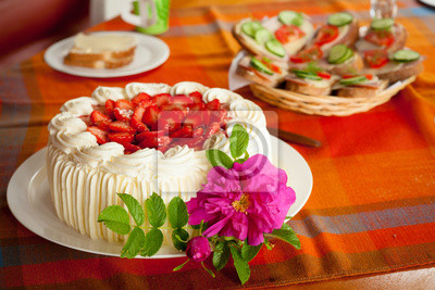Delicious strawberry cake on coffee table