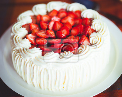 Delicious strawberry cake with whipped cream