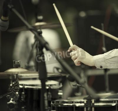 Wall mural detail of a drummer on the rock concert, selective focus on hands