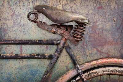 Wall mural Detail of a rusted ancient bicycle with leather seat