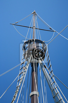 Wall mural detail of crow nest and rigging ropes in replica of ancient boat caravel of Christopher Columbus when discovered America in 1492, docked at harbor Palos de la Frontera, Huelva, Andalusia, Spain