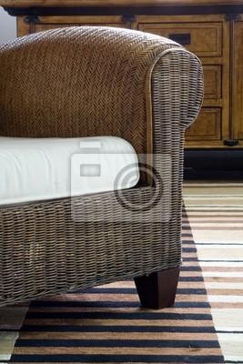 Detail of stylish rattan armchair
