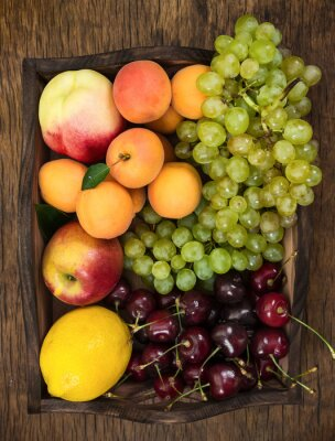 Different fruits in wooden tray
